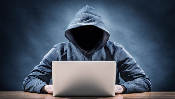 A hacker on a computer used to illustrate the story.