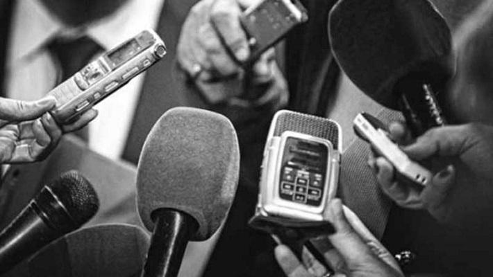 Journalist conducting an interview.