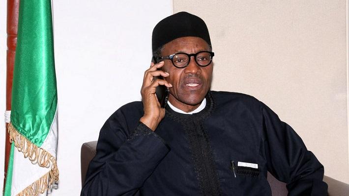President Buhari on Call. [PHOTO CREDIT: Presmium Times]