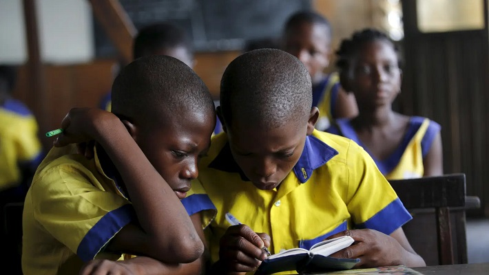 School children reading used to illustrate the story.